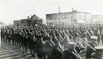 Red Deer Archives, P147; 12th Canadian Mounted Rifles marching to CPR Station, 1915