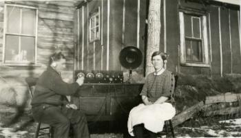 Red Deer Archives, P434; Man and woman listening to short wave radio, 192?