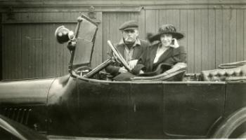 Red Deer Archives, P435; Arch Mitchell and wife in an open top car, 192?