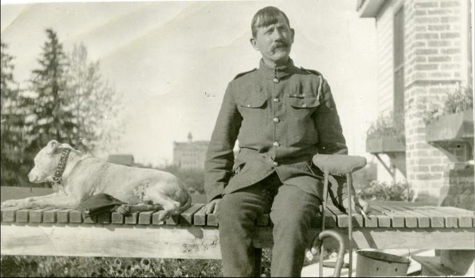 Red Deer Archives, P5422; A convalescing veteran and his dog on a porch of a house in Red Deer, 1918