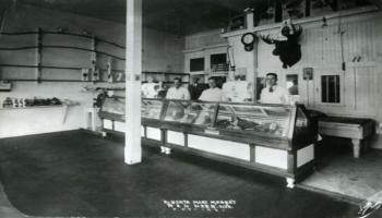 Black and white photo of inside the Alberta Meat Market in 1931.