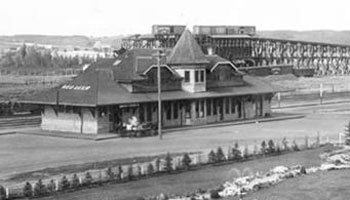 Black and white picture from 1910 of CPR Station and Park.
