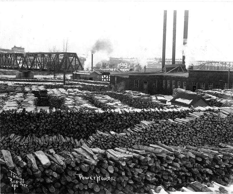 Black and white photograph of the number one power plant with the C.P.R Bridge in the background estimated in 1911.