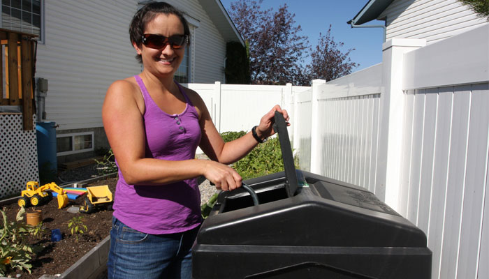 picture of woman working with her composter