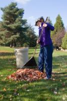 Women raking yard waste leaves (JPG)
