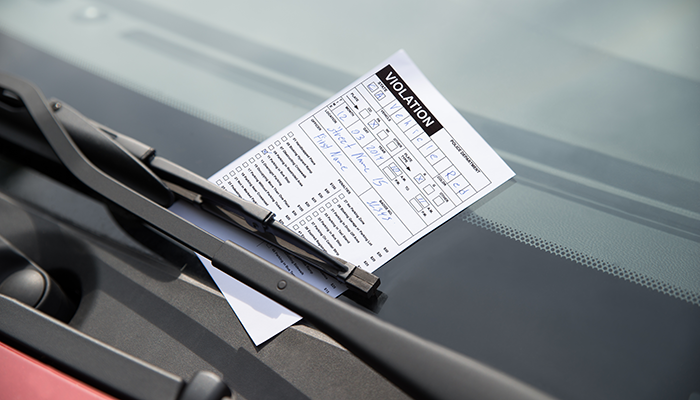 Parking ticket on vehicle windshield