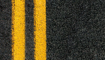 An aerial close up of of a road