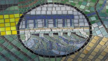Glass mosaic tile designed to look like a dam.