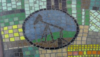Glass mosaic tile designed to look like an oil pumpjack.