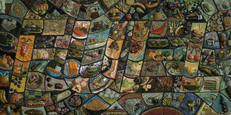Colorful mosiac tiles that spell the word Fuel. Each tile consists of a food item.