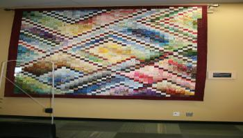 Made from 2013 donated cotton squares, this large quilt commemorates the City of Red Deer centennial in 2013. It was machine quilted in Red Deer's