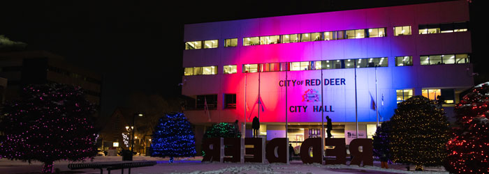 City Hall lit up with coloured lights