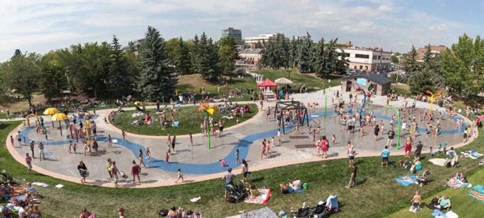 lots of people enjoying the Blue Grass Sod Farms Central Alberta Spray and Play park area