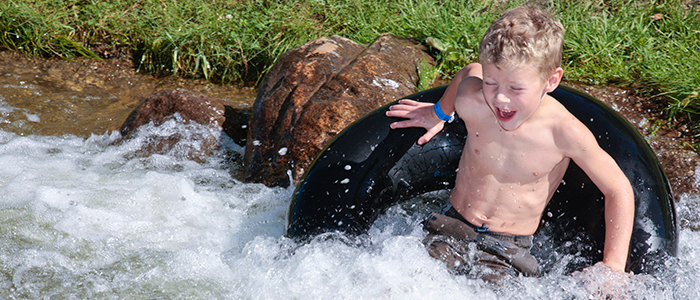 A young child tubing at discovery canyon