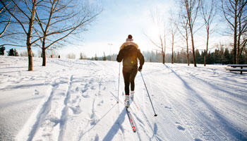 photo of woman cross-country skiing